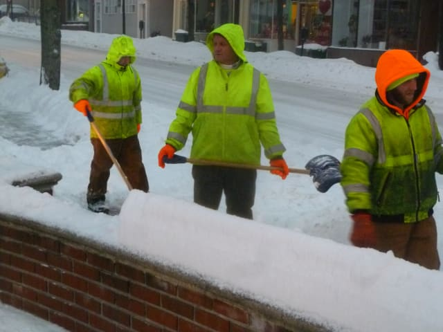 Hastings Department of Public Works personnel clear sidewalks during Wednesday's storm
