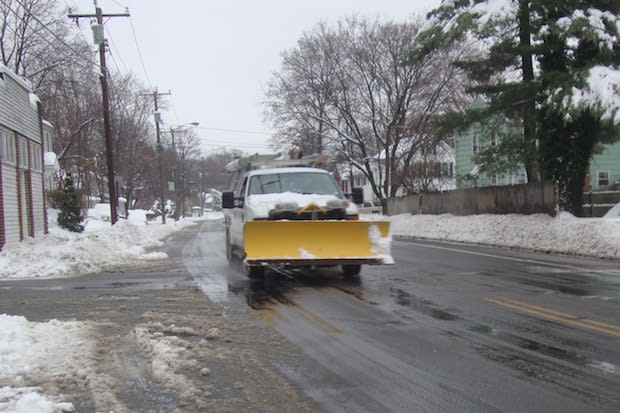 Plow crews were driving all around Norwalk Wednesday to clear out many snowed-in roads.