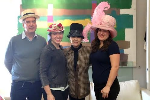 ArtsWestchester workers show off creative hats.