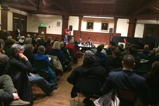 The room at the Pequot Library in Southport is packed with people from all over Fairfield County who want to talk directly to Metro-North and state Department of Transportation representatives about their concerns for train service.