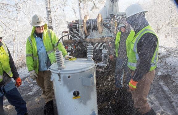 Connecticut Light & Power crews help to restore power during a storm on Cape Cod on Feb. 18. Workers are preparing for the storm headed for Fairfield County late Sunday,.