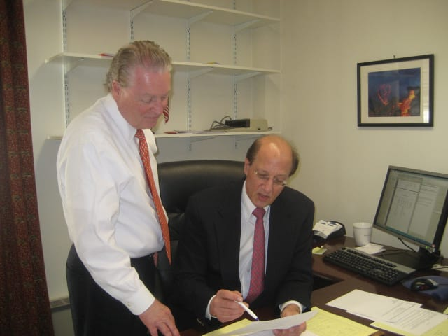 Fairfield First Selectman Mike Tetreau works on the 2014-15 budget with Robert Mayer, the town's CFO.