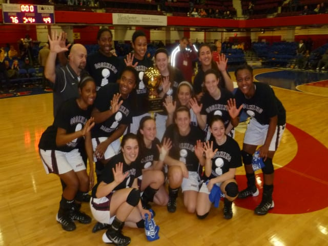 The Ossining girls basketball team seen here after winning the Section 1 title Sunday, won their state regional semifinal game Tuesday in Newburgh.