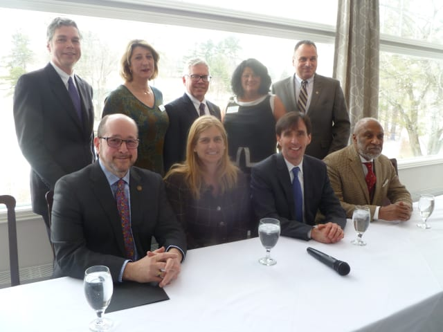 The Women's Council of Realtors President Roseann Paggiotta, back row second from right, welcomed six mayors and representatives to the group's meeting. The moderator, Leah Caro, Principal Broker of Bronxville-Ley Real Estate, second from left, back.