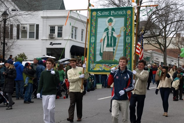 Thousands watch as Greenwich's 40th Annual St. Patrick's Day Parade makes its way down Greenwich Avenue on Sunday.