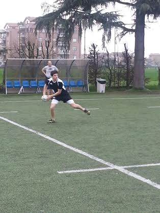 Charlie Seider of Scarsdale carries the ball in a practice drill as assistant coach Mark Brandon looks on.