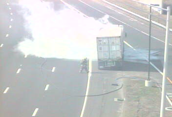 A tractor-trailer is on fire near the Darien Service Plaza on southbound I-95.