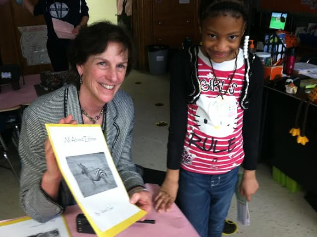 Springdale Elementary School principal Anne Downey and first-grader Kitana Taylor show off one of the displays at the Stamford school's Creature Creation Museum.