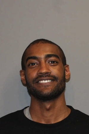 Noel Alston, 24, was arrested in Norwalk and charged as a fugitive after fleeing stalking charges in Massachusetts, police said.