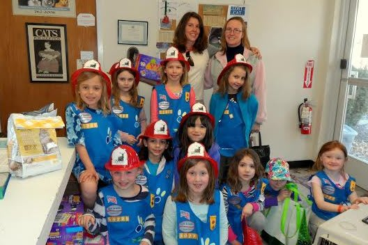 Girls from Wilton Daisy Troop 50229 helped Animals in Distress after the agency rescued 14 cats.