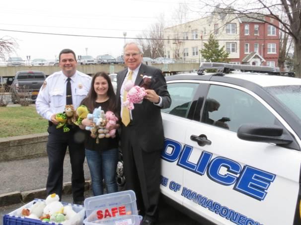 From left, Mamaroneck police Lt. Dominick Falcone, Rachel Cohen and Mamaroneck Mayor Norman Rosenblum.