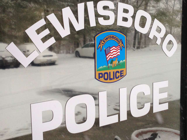 The Lewisboro Police Department is in the Cross River Shopping Center behind the DeCicco's Market.