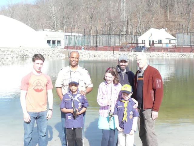 From left are Wilton Fishing Club President Max Jones, Cub Scout leader Reggie Fields, Helen Cherichetti, Lars Cherichetti and Dean Keister of Trout Unlimited. In front are Scouts R.J. Fields and Henry Cherichetti.