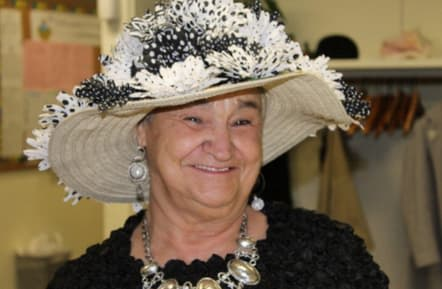 MJ Turanica shows off her Derby bonnet at the Hugh Doyle Senior Center in New Rochelle on Saturday, May 3.