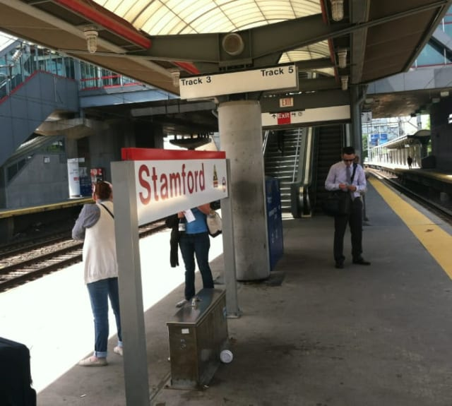 Commuters wait for the 11:25 a.m. train to Grand Central Terminal on Monday in Stamford. A fire Saturday in Cos Cob damaged an important switching station, Metro-North officials said.