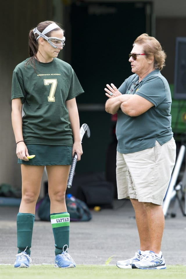 Greenwich Academy sports mainstay Angela Tammero will retire at the end of the school year. Here, she speaks with 2013 field hockey co-captain Annie Leonard.