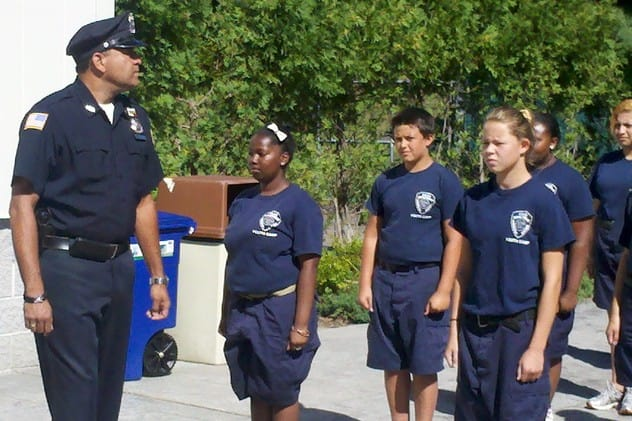 Greenburgh Police Officer David Zenon, a Summer Youth Camp instructor. put his cadets through their paces at the 2013 graduation