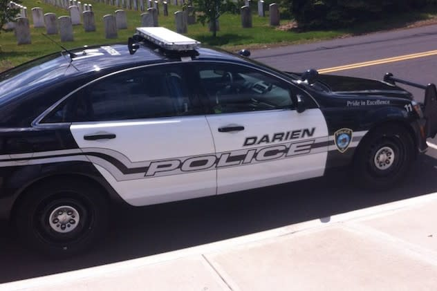 Darien police charged Marc Devico with risk of injury to a minor and evading responsibility after neighbors said he ran over a sign with his truck.