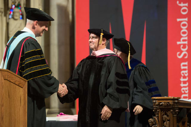 Peter Robbins, right, receives his honorary doctorate from Manhattan School of Music President James Gandre