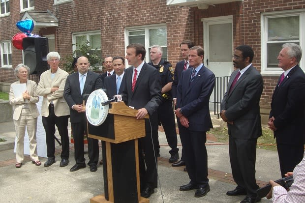 Federal, state and local officials gather at Norwalk's Washington Village to announce a $30 million HUD grant to revitalize the housing complex.