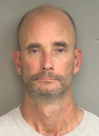 John William King, 45, of Enfield was arrested Sunday on charges of impersonating a police officer in an encounter with a woman early Sunday in Stamford.