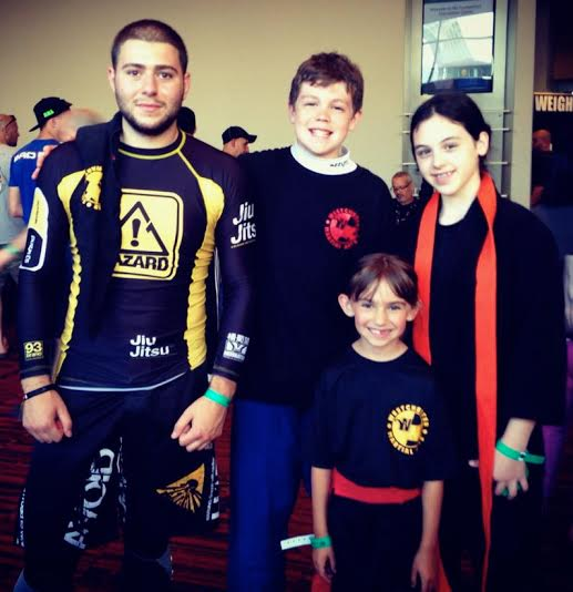Competing at the recent NAGA competition, from left, grappling coach/instructor Ron Barone, Aidan Connolly, Lauren Naclerio and Alexa Grassi.