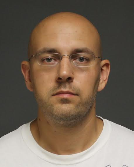 Fairfield resident Allen Liptak, 38, was charged by police with disorderly conduct and violation of a protective order and brought to the police station for processing.