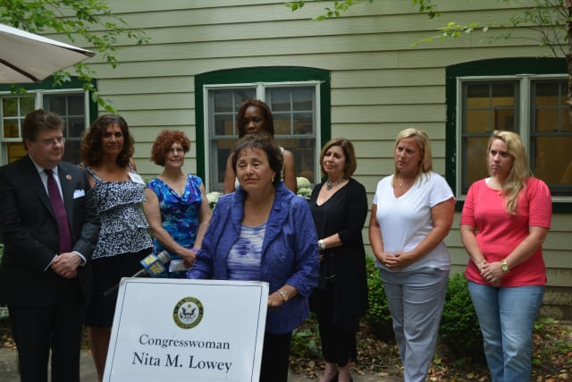 Rep. Nita Lowey, center, at a press conference at Mount Kisco Child Care Center.