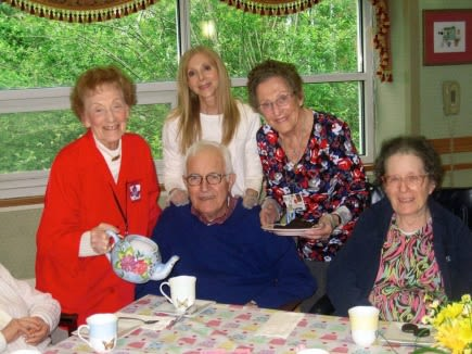 Dorothy Sunshine and Elaine Schenkerman hold a formal tea for Alzheimer's patients.