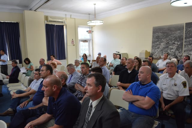 Members of the public spoke about the proposed police consolidation between Mount Kisco and Westchester County. Pictured are attendees.