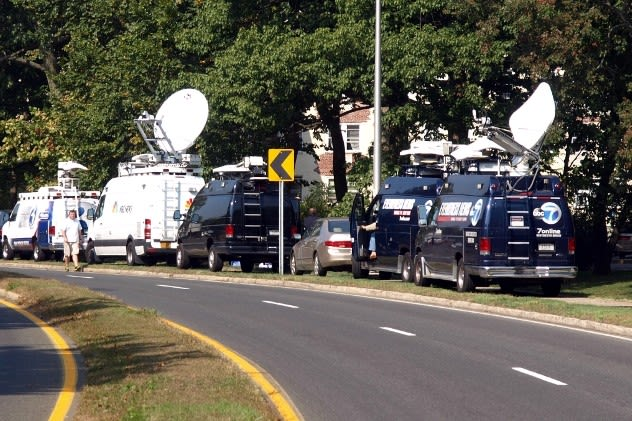 Satellite trucks line Washington Boulevard in Stamford on Oct. 4 as officials investigate the shooting death of a Stamford woman by Capitol Police. Investigators were searching her home for evidence in the case.