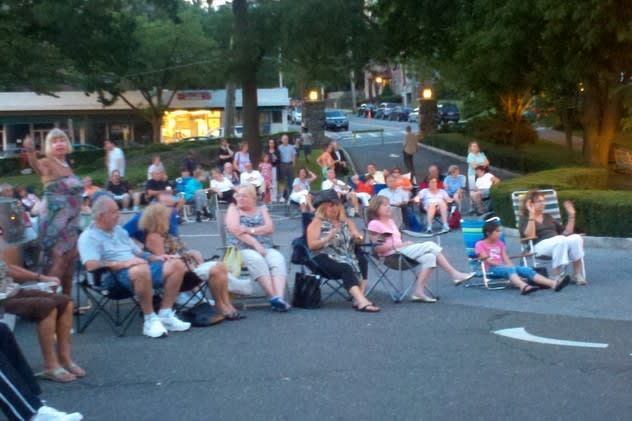 Eastchester residents enjoying a concert last year. The venue has changed, but the music stays the same.