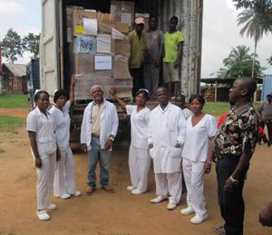 The staff at Ganta United Methodist Hospital in Liberia receives AmeriCares medicine and supplies.