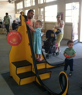 "Children learn and play with Westchester Children's Museum's ""Build Your Own Roller Coaster"" Exhibit."
