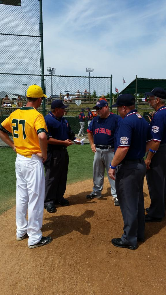 Danbury and Idaho exchange lineups prior to Monday's game at the Cal Ripken World Series in Aberdeen, Md.