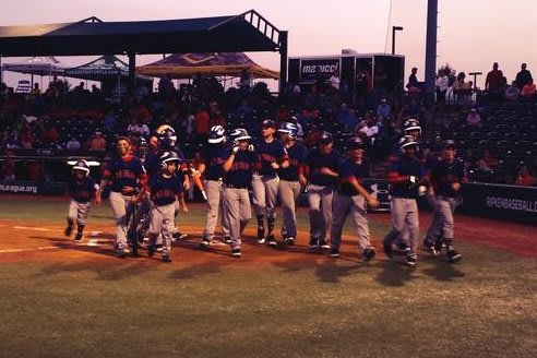 Javon Hernandez is congratulated by Danbury teammates after hitting a two-run home run on Wednesday night.