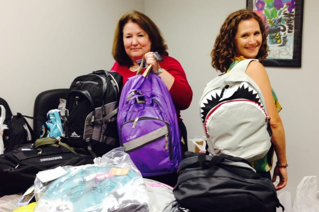 Norwalk's Family and Children's Agency received backpacks with school supplies to give to children as they head back to school.