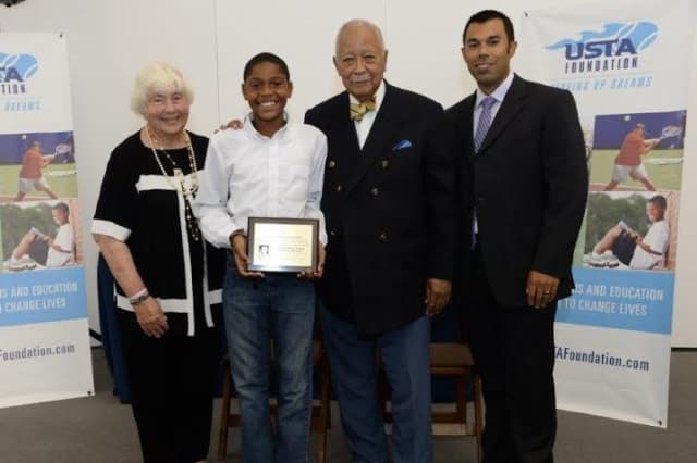 From left to right: Barbara Wynn, Arthur Ashe Essay Contest Founder; Torianh Blakes, boys 11-12 winner; David Dinkins, former Mayor of New York City; and Dan Limbago, USTA Foundation Programs & Services National Manager.