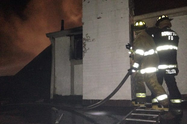 Rowayton firefighters spent three hours battling a blaze on Witch Lane Thursday night.
