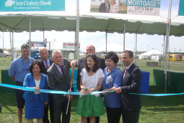 Norwalk officials, the Norwalk Seaport Association and First County Bank celebrate the upcoming Oyster Festival with a ribbon cutting Wednesday.