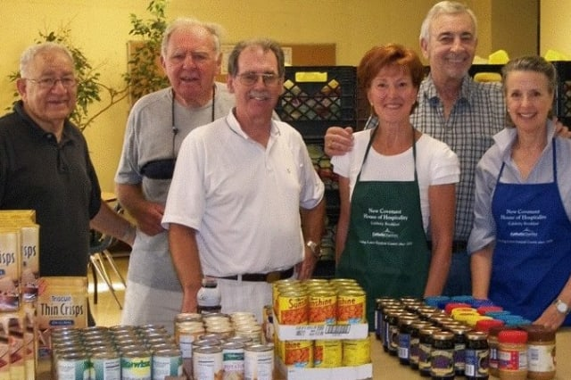Volunteers at New Covenant House serve food to hungry people in Stamford. The fourth annual Harvest Table to support New Covenant House will be held on Nov. 2 at The Country Club of Darien.