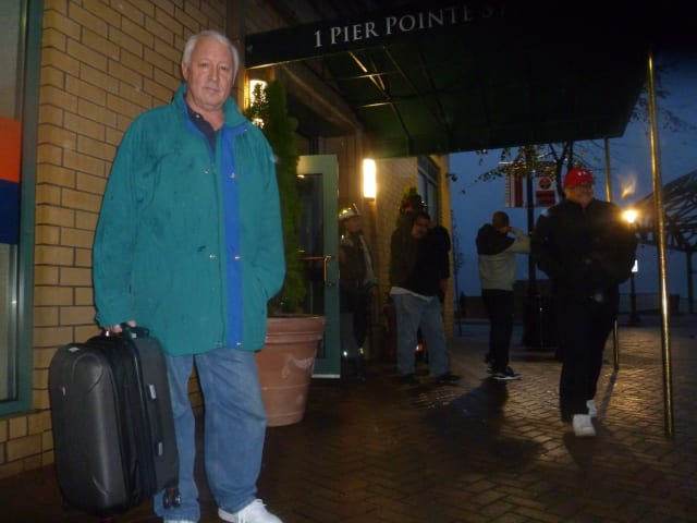 Mark Sternfeld evacuates his 1 Pier Pointe home Monday as part of a voluntary evacuation issued by  Yonkers in anticipation of five-foot storm surge.