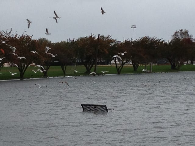 A bench at Harbor Island is partially submerged as Hurricane Sandy approaches the tri-state area.