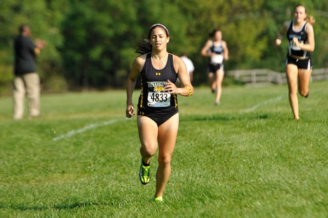 Kara Bucaro of Weston ran a personal best for Towson University in last week's Colonial Athletic Association cross country championships.