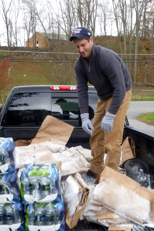 Sen. Greg Ball hands out dry ice in Lewisboro on Wednesday. He was critical of NYSEG's response to the blackouts.