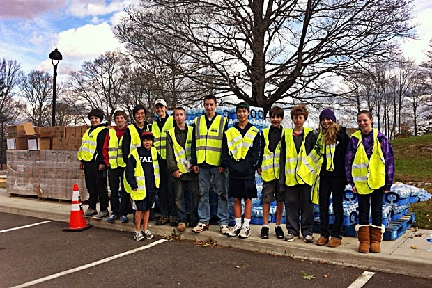 Ridgefield Boy Scout Troops 116, 76 and Girl Scout Troop 50675 helped out in the aftermath of Hurricane Sandy by handing out Meal Ready to Eat and water outside the Yanity Gym shelter.