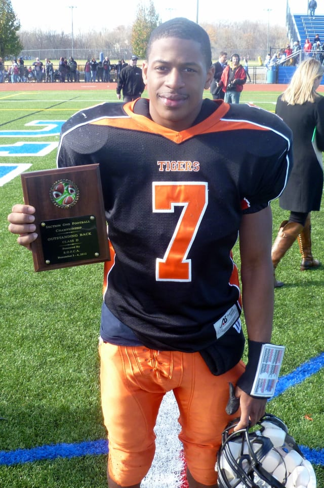 Tuckahoe's Shyheim Nixon holds his offensive MVP plaque from the Section 1 Class D championship game.