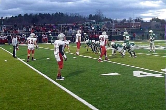 The Sleepy Hollow football team (in white) lines up for the final play in its sectional semifinal win against Brewster.