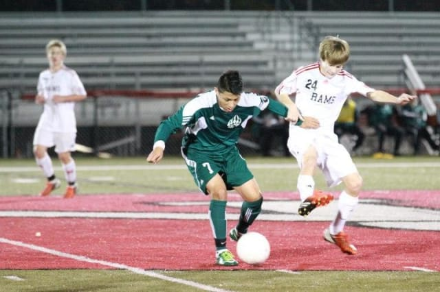 Norwalk's Alejandro Rivera controls the ball during a game against New Canaan earlier this year. The top-seeded Bears play Wilton in the semifinals of the FCIAC boys soccer playoffs on Tuesday.