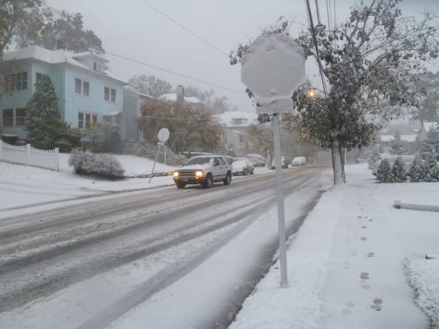 A layer of snow was already covering Van Cortlandt Park Avenue in Yonkers Wednesday afternoon, making roads slick for drivers.